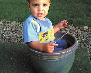 "John Cruz of Boardman says his son, Jadon Emmanuel Cruz, was 1 when this picture was taken. He jokes that Jadon looks like he was ""planted and growing like a weed!"""