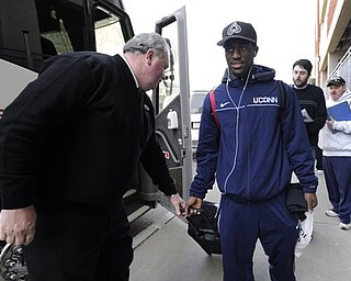 Connecticut's Kemba Walker boards a bus on campus bound for the airport in Storrs, Conn., en route to Houston, Wednesday, March 30, 2011.  Connecticut will face Kentucky in NCAA Final Four Game in Houston Saturday.