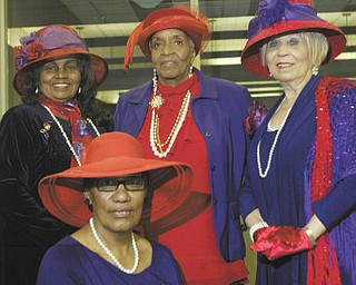 William D. Lewis | The Vindicator: Members of A String of Pearls, the local chapter of the Red Hat Society, show off their finery in anticipation of the upcoming International Red Hat Day Luncheon on April 20. Seated is Erma Hart, and standing, from left, are Anna Harrell, Tommicean Burney and Audrey Gillian.