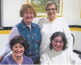 Tri-Gold officers preparing for the group's annual auction for its scholarship fund are, in front, from left, Sharon Pasquale and Jolyn Bush, and back, Donna Farmer and Mary Ann David. The basket auction will take place April 9 at St Nicholas parish hall in Struthers.