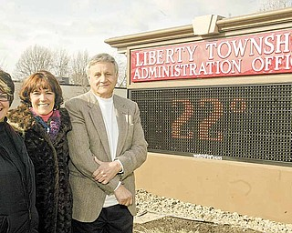A new energy-efficient and computer-operated sign recently was installed at Liberty Township Administration Building, 1315 Church Hill-Hubbard Road. Standing by the new sign, from left, are June Smallwood, director of parks and special projects; Jodi Stoyak, trustee; and Pat Ungaro, township administrator. The sign was funded by a grant from Northeast Ohio Public Energy Council. Smallwood wrote the grant.
