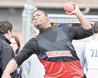 Kejuan Kelly of Campbell Memorial High School compete in the shot put during the Joe Lane Invitational track and field event Saturday  at Mineral Ridge High School. McDonald boys finished first with 126 points, and 