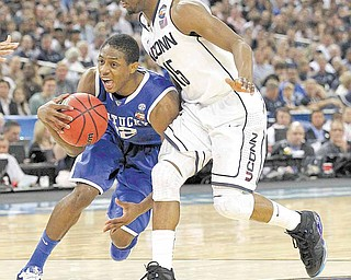 Kentucky's Brandon Knight battles past Connecticut defender Kemba Walker during the first half in the men's NCAA Final Four semifinals at Reliant Stadium in Houston, Texas, Saturday, April 2, 2011.