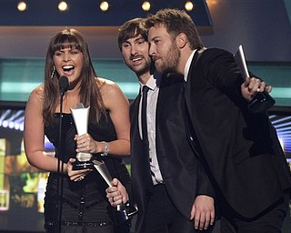 From left, Hillary Scott, Dave Haywood and Charles Kelley, of Lady Antebellum, accept the award for album of the year at the 46th Annual Academy of Country Music Awards in Las Vegas on Sunday, April 3, 2011.