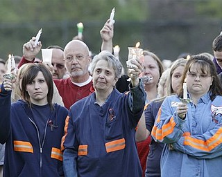 """In this file April 10, 2010 file photo, people from the coal mining towns along the Coal River participate in a memorial vigil in Naoma, W.Va., for 29 miners who died in the explosion at Massey Energy Co.'s Upper Big Branch mine in Montcoal, W.Va. A year since the disaster, Massey Energy company and their CEO Don Blankenship, """" King of Coal"""" , are no longer around."""