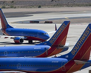 A  Southwest Airlines jetliner maneuvers around the tarmac at Phoenix Sky Harbor International Airport on Monday, April 4, 2011 in Phoenix.  The peeling away of a 5-foot-long hole recently on a Southwest Jet as the plane traveled at 35,000 feet raised questions about how vulnerable the world's passenger air fleet is to similar cracks, and federal aviation officials were considering ordering more widespread inspections.