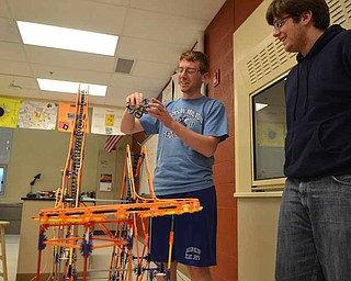 Seniors Bobby Collins, left, and Ben Clark examine their roller coaster days before the competition deadline. The Jackson Milton High School students were part of a small group that met during study hall and after school to complete the project for a nationwide competition.