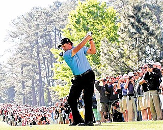Phil Mickelson tees off on the seventh hole during a practice round for the Masters golf tournament Wednesday, April 6, 2011, in Augusta, Ga.
