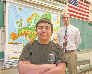 Four-time Boardman Glenwood Geography Bee champion Michael Palagano advanced all the way to the final round of the state bee last Friday before he was defeated on a sudden-death overtime question. Palagano credits his success to his father, Michael, and social studies teacher Vince Carnevale, pictured, who helped him study throughout his middle school years.