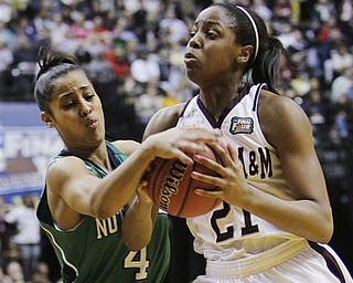Notre Dame's Skylar Diggins (4) tries to strip the ball from Texas A&M's Adaora Elonu (21) in the first half of the women's NCAA Final Four college basketball championship game in Indianapolis, Tuesday, April 5, 2011.