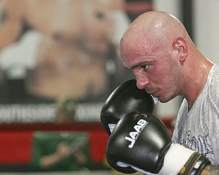 Kelly Pavlik is back in the ring, sparring Romaro Johnson, and conditioning for his upcoming bout in May. He's pictured here in at Jack Loew's South Side Boxing Club in Youngstown.