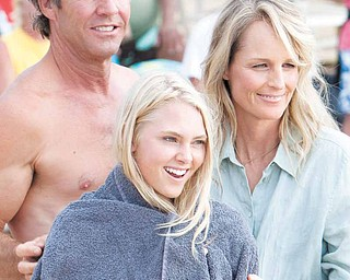 """In this film publicity image released by TriStar Pictures, Dennis Quaid, AnnaSophia Robb, center, and Helen Hunt are shown in a scene from """"Soul Surfer."""" (AP Photo/TriStar Pictures, Mario Perez)"""