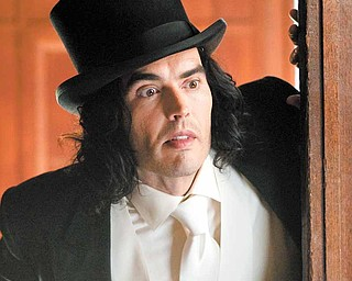 """In this film publicity image released by Warner Bros. Pictures, Russell Brand is shown in a scene from """"Arthur.""""  (AP Photo/Warner Bros. Pictures, Barry Wetcher)"""