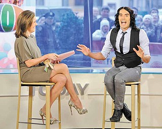 """In this photo released by NBC, """"Today"""" show co-host Meredith Vieira talks with actor Russell Brand on the """"Today"""" show about his new movies """"Hop"""" and """"Arthur,"""" Wednesday, March 30, 2011, in New York. (AP Photo/NBC, Peter Kramer) NO SALES"""