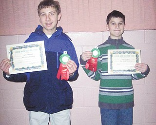 """Parla italiano? Sì: Michael Angiolelli, at left, and Victor DiTommaso, both students at Holy Family School in Poland, came up winners at the 35th annual Italian Language Contest on March 12 at Youngstown State University. Michael took first place at the eighth-grade level for his poem """"Carnivale,"""" and Victor won first prize at the fifth-grade level for his poem """"Il Febbraio."""" Nearly 200 high school and elementary students who are studying Italian participated."""