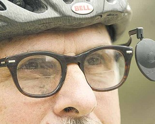 Paul Kobulnicky of Poland, a librarian at Youngstown State University's William F. Maag Library, gets ready to ride his bicycle. The city of Youngstown has a new map to show riders the easiest, moderate and hardest bicycle routes through city streets.