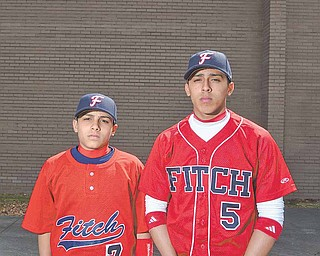Brothers Alex, left, and Kevin Sierra of Austintown moved from Puerto Rico to the United States to play baseball. Kevin, 16, made the varsity team at Fitch High School, and Alex, 14, made the freshman team.