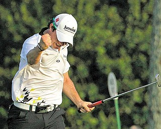 Rory McIlroy of Northern Ireland reacts after making a birdie putt on the 17th hole during the third round of the Masters golf tournament Saturday, April 9, 2011, in Augusta, Ga.