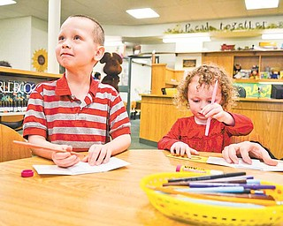 """Brody Cheney, 5, and his sister, Noelle, 3, create """"All About Me"""" books at a craft table in the children's room at Hubbard Public Library, 436 W. Liberty St., Hubbard. The library hosted an open house Sunday afternoon, and about 200 people attended."""