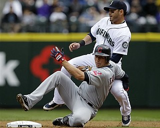 Seattle Mariners second baseman Adam Kennedy, right, becomes tangled with Cleveland Indians' Asdrubal Cabrera after Kennedy tagged out Cabrera at second base in the first inning of a baseball game Sunday, April 10, 2011, in Seattle. Cabrera singled in a run on the play, but was caught at second base.
