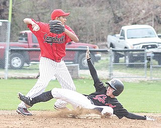 Girard baserunner Dominic Aurilio tries to break up a double play as Campbell infi elder Joel Cruz sets to throw during Monday's game in Girard.