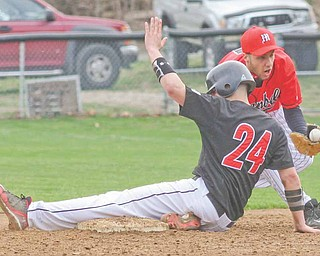 Girard baserunner A.J. Weibel takes third base as Campbell infielder Brandon Reyes fields the throw during the Indians' 12-1 win.