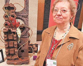 More than 175 attended the Garden Club of Ohio's convention Tuesday in Boardman. Sheila Bowman stands next to the overall winner, submitted by the Center of Industry and Labor.