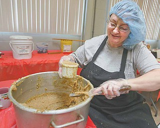 Dina Reeves measures the right amount of nut mix for the kolachi.  The sweet bread rolls made by a church women's group in Boardman come in four varieties of fillings.