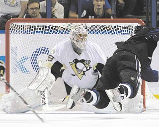 Tampa Bay Lightning left wing Ryan Malone, right, flies through the air after getting tripped by Pittsburgh Penguins left wing Mike Rupp (17) in front of Penguins goaltender Marc-Andre Fleury (29) during the third period of an NHL hockey game Thursday, March 31, 2011 in Tampa, Fla. Rupp drew a two-minute penalty for tripping. The Lightning won 2-1.