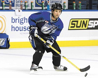 Tampa Bay Lightning right wing Martin St. Louis stick handles during hockey practice for their first-round NHL playoff series against the Pittsburgh Penguins Tuesday, April 12, 2011 in Tampa, Fla.  Game One of the best-of-seven series begins Wednesday night in Pittsburgh.