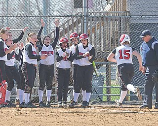Youngstown State's Vicky Rumph runs to home as her teammates wait and congratulate her during the first game of a doubleheader against the Detroit Titans at McCune Park in Canfield.