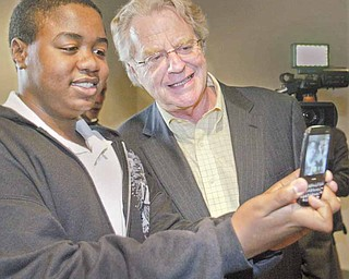 Oscar Aslam, 14, of Austintown snaps a photo of himself with TV talk-show host and former Cincinnati Mayor Jerry Springer during the Mahoning County Dem-ocratic Party Hall of Fame dinner at Mr. Anthony's in Boardman on Thursday. Springer was the guest speaker.