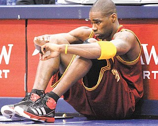 Cleveland Cavaliers power forward Antawn Jamison (4) sits in front of the scorer's tables waiting to be subbed in during the first half of the NBA basketball game against the Dallas Mavericks in Dallas,  Monday, Feb. 7, 2011.  (AP Photo/LM Otero)