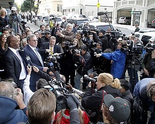 Barry Bonds, left, and his attorney Allen Ruby face the media outside a federal court building Wednesday, April 13, 2011, in San Francisco. The former baseball player was convicted of one count of obstruction of justice. The jury failed to reach a verdict on the three counts at the heart of allegations that he knowingly used steroids and human growth hormone and lied to a grand jury about it. (AP Photo/George Nikitin)