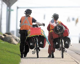 """Lee """"Shiloh"""" Pickering, 61, left, and his wife, Ruthie, 33, of Portland, Ore., travel through Youngstown. They stopped here Friday to visit a relative. They hope to be in Connecticut on May 1. They started their bicycle trip in their hometown Oct. 27, 2010."""