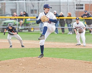 RAMI DAUD | THE VINDICATOR .Fitch's Scott Pierce pitches while Candield's Derek Turocy prepares to steal second base. .
