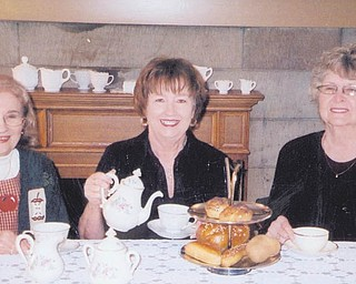 From left, Rae Jeanne Mollica, Marge Goldner and Joyce Pogany display a bit of what's in store at the spring high tea planned for May 1 at Strock Stone House, an Austintown national historic landmark. Reservations are required before April 22. This is the 19th high tea the Austintown Historical Society has sponsored, and all proceeds go to the society.