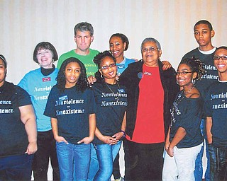 Eight local high school students were among the 90 others who participated in a recent 10-day Sojourn to the Past. Pictured are, from left, Shameka Walker of Youngstown Early College; Penny Wells of Sojourn, who prepared the students for the trip; Da'Nazha Fludd, YEC; Sean Barron, who accompanied the group; Shaniece Howell, YEC; Shatasia Walker, Chaney High School; Minnijean Brown Trickey, one of the Little Rock Nine; and Brittany Harris, Nigel Baldwin and Cordell Jackon, East High School. Missing the from picture is Gregory Jones of YEC.