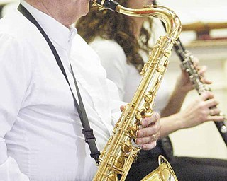 John Yaksich plays saxophone with the Dixie Dandies.