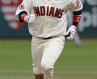 Cleveland Indians' Orlando Cabrera rounds the bases after hitting a two-run home run in the seventh inning of a baseball game against the Baltimore Orioles, Saturday, April 16, 2011, in Cleveland.