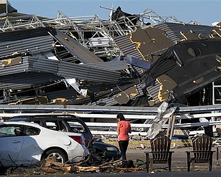 Annina Purdy, who was inside the Lowe's hardware store in Sanford, N.C. the previous day when a tornado destroyed the building, returned to the store's parking lot on Sunday, April 17, 2011, to reclaim personal belongings from her car.