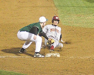 Ursuline infi elder Harrison Finelli puts the tag on Cardinal Mooney's Boo Vazquez during their game Monday night in Struthers.