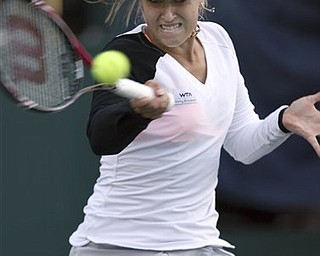 Sabine Lisicki, of Germany, returns a shot against Sania Mirza, of India, during the Family Circle Cup tennis tournament in Charleston, S.C., Thursday, April 7, 2011. Mirza defeated Lisicki 6-4, 6-4.
