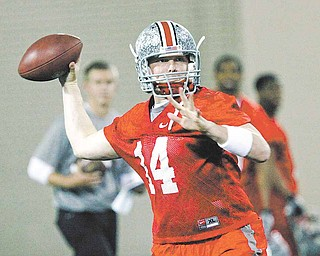 In this March 31, 2011 file photo, Ohio State quarterback Joe Bauserman (14) throws a pass during the first day of NCAA college football practice in Columbus, Ohio.