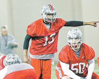 In this photo made March 31, 2011, Ohio State quarterback Kenny Guiton (13) calls out a play during the first day of NCAA college football practice in Columbus, Ohio.