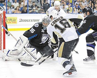 Tampa Bay Lightning goalie Dwayne Roloson (35) stops a shot by Pittsburgh Penguins right wing Chris Conner (16) during the third period in Game 4 of a first-round NHL Stanley Cup playoff series on Wednesday, April 20, 2011, in Tampa, Fla.