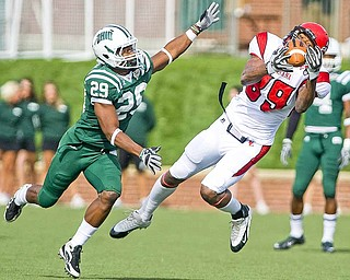 Louisiana-Lafayette tight end Ladarius Green reaches for a pass as Ohio safety Donovan Fletcher defends during the first half of an NCAA college football game, Saturday, Oct. 30, 2010 at Peden Stadium in Athens, Ohio.