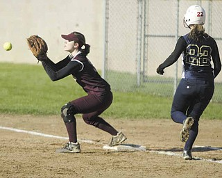 Liberty's first baseman Julie Mickulich catches the ball to make the play before Brookfield's Haley Hogue can reach the base during the first inning of Thursday's game in Liberty. The Warriors defeated the Leopards, 8-4.