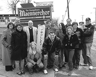 Waiting for the trolley, which will transport them throughout the downtown area during the Spring Fest, are members of the Mahoning Commons Association, in front, from left, Annie Gilliam, Youngstown City Council; Marcy Applegate, Artists of the Mahoning Commons; Todd Hancock, Easy Street Productions; and Mary Farragher, Calvin Center; and, in back, Sharon Letson, Youngstown CityScape; Keith Kaiser, Fellows Riverside Gardens, Mill Creek Park; the Rev. George Dunbar, Rockview Christian Church; Jacob Harver, Lemon Grove Café; Lynn Caldwell, Artists of the Mahoning Commons; Bill Lawson, Mahoning Valley Historical Society; and Chris and Michael Golec (holding Cayden Golec) of Jubilee Limousine.