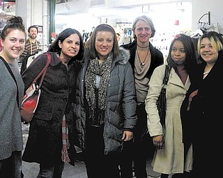 YSU fashion-merchandising students and their professor who recently spent four days in New York City experiencing different aspects of the fashion industry are, from left, Jennifer Daly, senior; Jennifer Frank, professor; Victoria Volpe, sophomore; fashion designer Nanette Lepore, with whom the students got a chance to spend time while they stopped in the city's Garment District; Kristen White, junior; and Shamaila Younus, junior.
